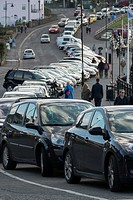 Cars parked in a serpentine shape around coastal path at the sea front in Clevedon, Somerset, England, UK.