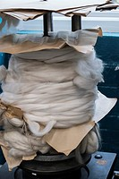 Gigantic metal spool of soft fuzzy wool with brown paper packaging, Bradford, England, UK.