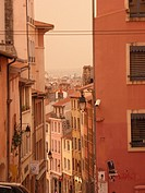 Warm mellow hues and repeating symmetry of traditional houses looking towards the historic city centre of Lyon, France.