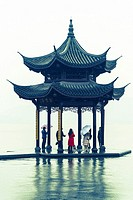 People in the Pagoda on the West Lake, Hangzhou, Zhejiang province, China.