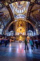 People in a religious mass in the Church of the Assumption of Mary, Saint Petersburg (Russia).