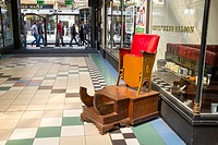 Old shoeshine or barbers chair outside gentlemens saloon in Manchester UK