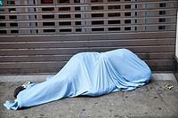 Man Sleeping Rough With Easter Eggs on Sidewalk - London UK.