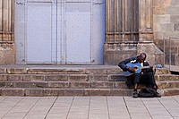 Street musician on the steps of Sant Just i Pastor Church. Gothic Quarter, Barcelona, Catalonia, Spain, Europe.