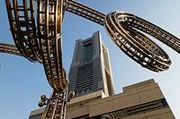 Yokohama, Japan - June 15, 2017: Futuristic stainless steel construction and the Landmark tower on Queen's Square shopping centre in Minato Mirai, Yok...