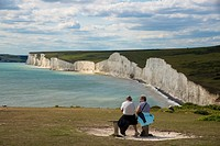 couple watching Seven Sisters, cliff coast at Beachy Head, Sussex, England