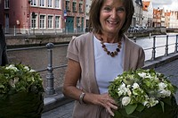 People in Bruges loves the flowers. In the picture, a florist show a nice bouquet.