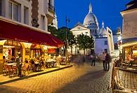 Evening at Place du Tertre in village of Montmartre, Paris, Ile-de-France, France.