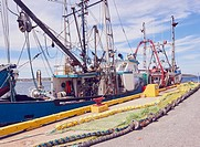 Fishing trawlers with nets on the jetty, Port au Choix, Newfoundland, Canada. . Known as the fishing capital of western Newfoundland it is also a desi...