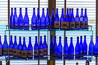 Bottles of Sake on Display in an Onboard Cruise Liner's Bar.