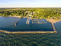 Aerial view of Lexington Michigan on Lake Huron showing a man made harbor and how it protects a marina from wind and waves.