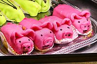 Marizpan pastry pigs in a shop window in Narbonne, France.