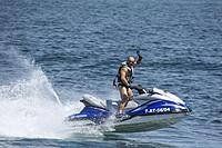Waiving man on a Jetski in the Mediterranean Sea at Tabarca Spain.