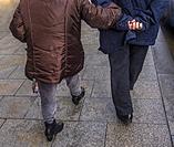 Older couple walking on the street