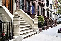 New York City, Manhattan, Upper West Side. Looking Down a Block of Brownstone Townhouses.