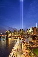 911 Tribute In Light In NYC II - View to the Brooklyn Bridge, the FDR highway and the Financial District during the Tribute In Light memorial. Seen ar...