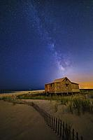 Jersey Shore Setting Moon and Milky Way - Island Beach State Park at the NJ Shore with beach fences leading to the Judge´s Shack underneath a starry s...