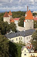 View to the medieval walls and towers in the old town with the St. Olav's Church at the background, Tallinn, Estonia, Baltic States, Europe.