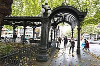Seattle, Washington: Visitors pass through the Iron Pergola at Pioneer Square as the first storm of the season lashes Seattle with high winds and rain...