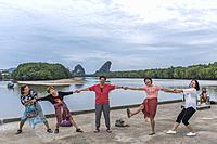 Female tourists happily holding hands at Krabi Town, Thailand, Asia