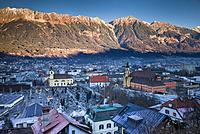 Austria, Tyrol, Innsbruck, elevated city view with the Wilten Basilica and Wilten Abbey Church, dawn, winter.