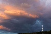 dramatic sky with clouds in evening light and telecommunication tower, Trier, Rhineland-Palatinate, Germany.