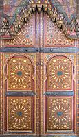 Morocco, Marrakech-Safi (Marrakesh-Tensift-El Haouz) region, Marrakesh. Painted wooden doors at the Heritage Museum, housed in a restored historic ria...