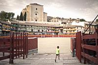 Boy running in Chinchón, Madrid province, Spain.