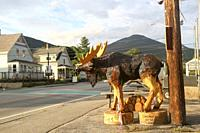 Carved wooden moose in front of the Pemi Valley Moose Tours office, Lincoln, New Hampshire, United States.