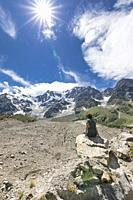 A girl enjoy in front of the East face of the Monte Rosa Massif and the Belvedere Glacier (Belvedere, Macugnaga, Anzasca Valley, Verbano Cusio Ossola ...
