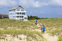 Avon, Outer Banks, North Carolina, USA. Father and Children Going to the Beach.