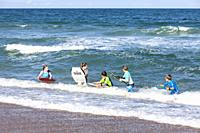 Avon, Outer Banks, North Carolina, USA. Children Playing on Boogie Boards in the Atlantic Surf.