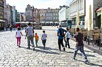 Family, Old Town Square, Poznan, Poland.