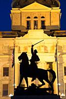 Thomas Francis Meagher statue with capitol at night, Montana State Capitol, Helena, Montana.
