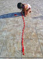 Little girl playing with letters.