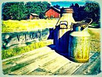 Milk churns outside farm, Ljustero, Sweden, Scandinavia
