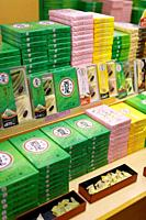 Traditional Japanese confectionery, Yatsuhashi triangles with red bean paste and samples, Miyagegashi souvenir sweets, on a store display in Kyoto, Ja...