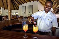 Bartender at Etosha Aoba Lodge, Onguma Game Reserve, Namibia, Africa.