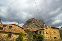 Houses and rock. Muda, Palencia province, Castilla Leon, Spain.