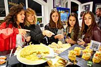 Group of tourists and guide making a tour of the city, Eating pintxos, Donostia, San Sebastian, Gipuzkoa, Basque Country, Spain, Europe