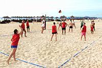 Tourists playing beach volleyball on Bikini Beach, Santa Maria, Sal Island, Salinas, Cape Verde, Africa.