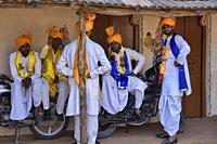 Rajasthani folk musicians relaxing, Udaipur, India.