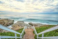 View of the ocean and coastline from stairs above Windansea Beach. La Jolla, California, USA.