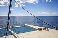 Tourist on a catamaran, journey in Saona island, Dominican Republic, West Indies,.