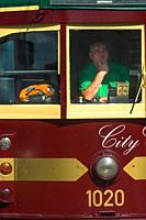 Closeup of traditional Tram with driver in Melbourne city centre, Victoria, Australia.
