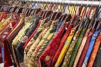 Colorful silk batik shirts on a rack in Hamzah Batik shop. Yogyakarta, Java, Indonesia.