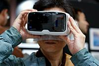 March 3, 2018, Yokohama, Japan - A man tries out a ZEISS VR One Plus (Virtual Reality Headset) at the CP+ Camera & Photo Imaging Show 2018 in Pacifico...