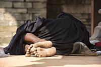 Homeless man in the UNESCO temples of Bhaktapur, Nepal.