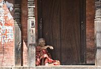 Old woman sitting, Bhaktapur, Nepal.