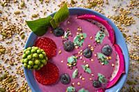 Acai bowl smoothie with chia strawberry blueberry seeds and pitaya dragon fruit.